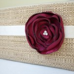 Tan clutch purse with wine burgundy flower for beach wedding