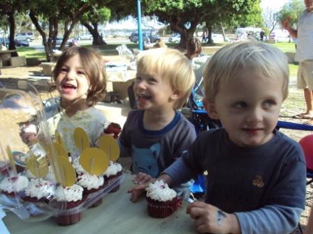 Kids Birthday party; Kids eating cupcakes